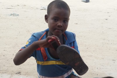 """Today, World Day Against Child Labour, is this 10-year-old boy's first day working as a shoe cleaner"""
