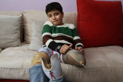 Courage of Syrian boy, 10, who lost his family and his legs in bombing but now loves school