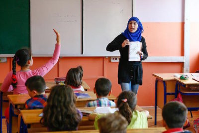 Turkey plans to get all Syrian refugee children into permanent schools within three years