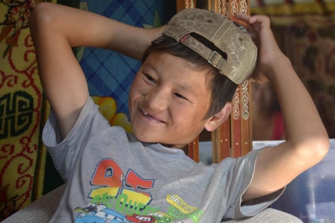 Mongolian child jockeys as young as five miss school and risk injury
