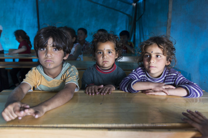 What happened to the promise to get every Syrian refugee in school?