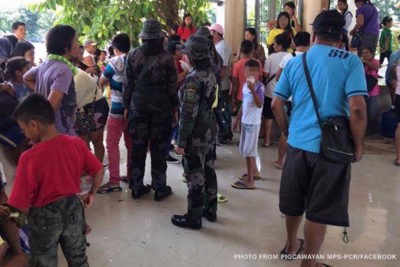 12 children freed after being held hostage in Philippines school gun battle
