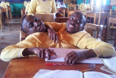 Tanzania mourns conjoined twins who graduated from high school