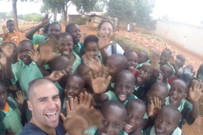 Craig quit his job to give high fives around the world - now he's helping young people in Kenya slum