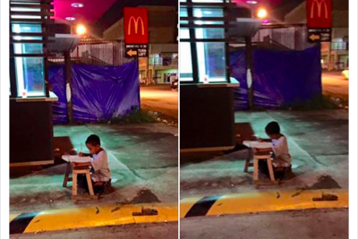 Ako Si Daniel: Philippines unites behind homeless boy pictured doing his homework in street