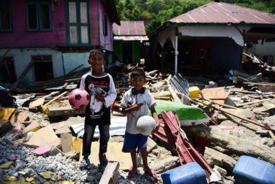 Children clean up classrooms as some schools reopen after Indonesia disaster