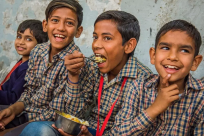 Indian boy eats the one billionth school meal provided by charity