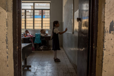 Three years after his last lesson, Ali and other children are back at school in war-torn Mosul