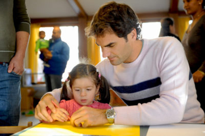 Caring Wimbledon stars who serve up education for deprived children