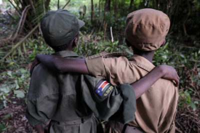 Arm in arm, these child soldiers are free to return home and go to school