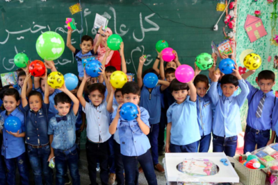 Day of celebration as Palestinian children go back to school amid funding crisis